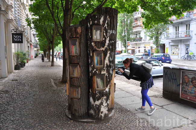 "This cluster of trees in the middle of a sidewalk is called ""The Berlin Book Forest."""