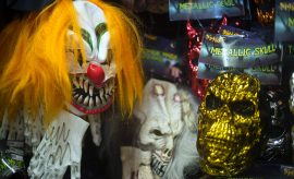 (FILES) This file photo taken on October 21, 2013 shows, Halloween masks on a wall at Spirit Halloween costume store in Easton, Maryland.  A series of creepy clown sightings across the United States has caused a wave of hysteria, forcing police and schools to scramble to contain spreading jitters, and even the White House to weigh in.  / AFP PHOTO / JIM WATSON